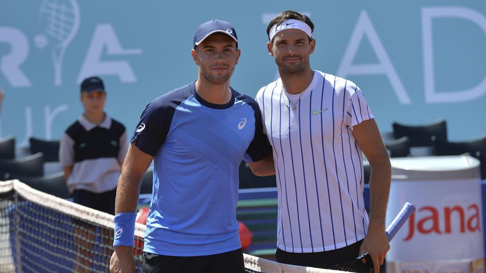 Bulgaria's Grigor Dimitrov, right, poses for cameras with Croatia's Borna Coric during their semifinal match at a tournament in Zadar, Croatia.