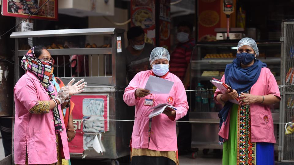 ASHA workers in a door to door screening survey for coronavirus in Pandav Nagar, New Delhi, India, on Friday, June 26, 2020.