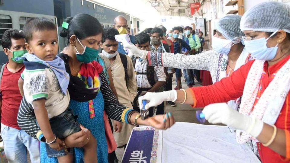 Migrants undergo screening at Danapur station in Patna during nationwide lockdown in the wake of the Coronavirus Pandemic.