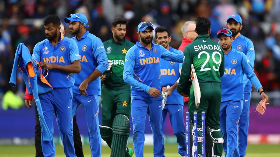 Virat Kohli (c) the captain of India shakes hands with Shadab Khan of Pakistan after his side's 89 run win on D/L Method during the Group Stage match of the ICC Cricket World Cup 2019 between India and Pakistan at Old Trafford on June 16, 2019 in Manchester, England.