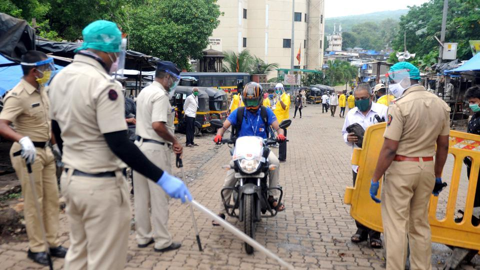 Police personnel stop commuters  in wake of the restrictions in place due to coronavirus pandemic in Mumbai on Friday.