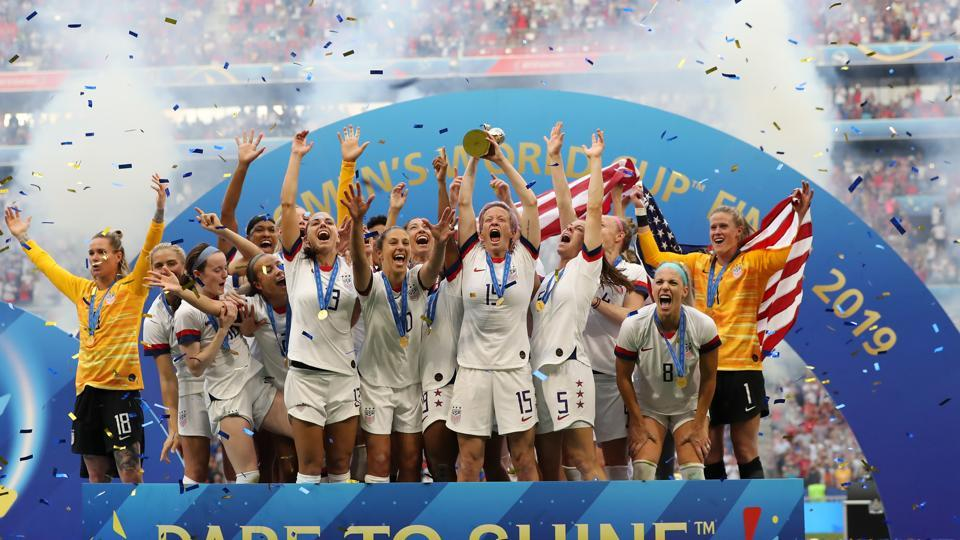 LYON, FRANCE - JULY 07: Megan Rapinoe of the USA lifts the FIFA Women's World Cup Trophy following her team's victory in the 2019 FIFA Women's World Cup France Final match between The United States of America and The Netherlands at Stade de Lyon on July 07, 2019 in Lyon, France. (