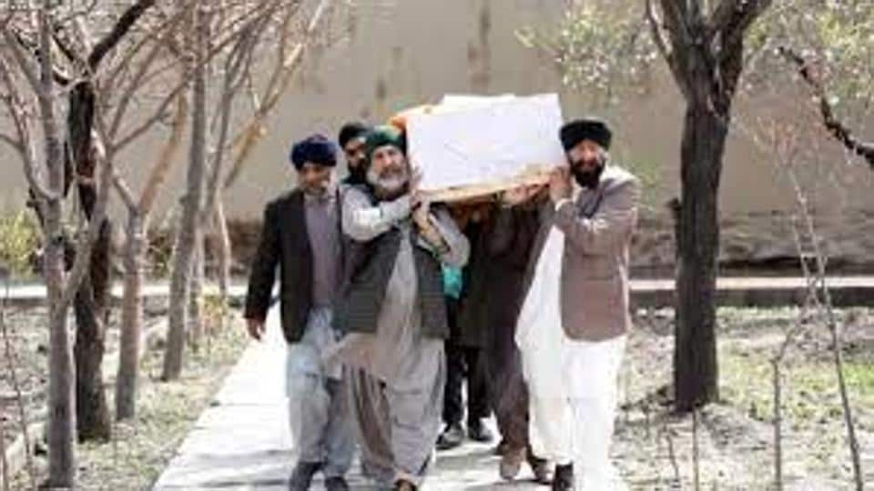 Afghan Sikh men carry a coffin of one of the victims who was killed during the attack at a Kabul gurdwara on March 25, 2020.