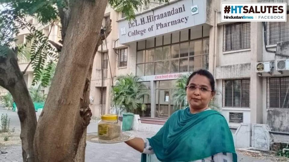 Sarita Khanchandani next to a bird feeder set up at Hiranandani College of Pharmacy, in Ulhasnagar, Maharashtra