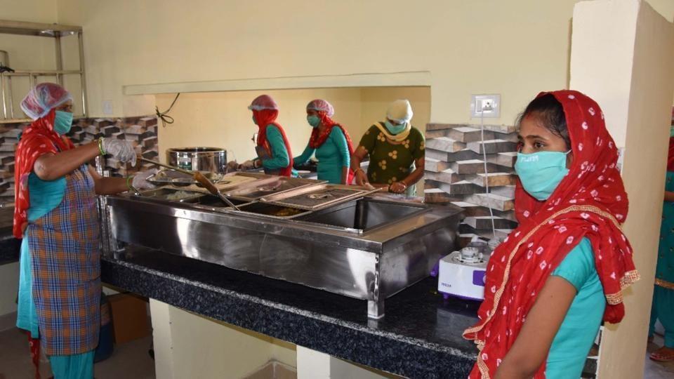 Members of a woman self-help group preparing food at an Atal Kisan-Majdoor Canteen in Rewari on Saturday.