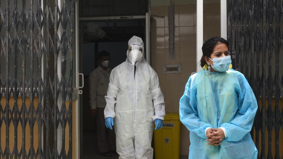 Medics wait for people at a coronavirus rapid antigen testing facility in a health centre in New Delhi.