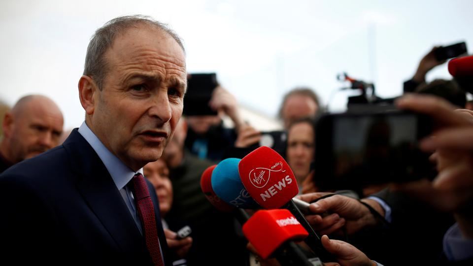 Fianna Fail leader Micheal Martin speaks to media after exit polls were announced in Ireland's national election, in Cork, Ireland.