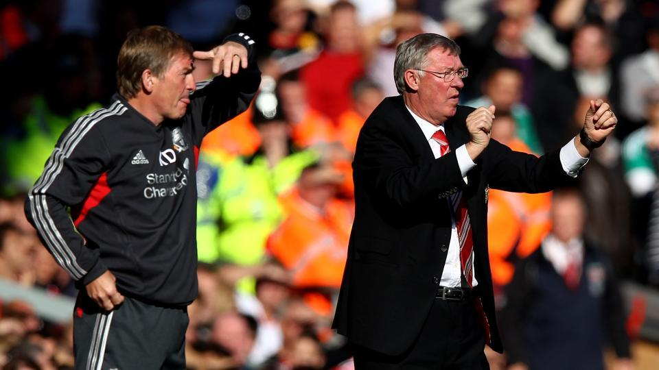 Manchester United Manager Sir Alex Ferguson (R) gestures as Liverpool Manager Kenny Dalglish looks on during the Barclays Premier League match between Liverpool and Manchester United at Anfield on October 15, 2011 in Liverpool, England.