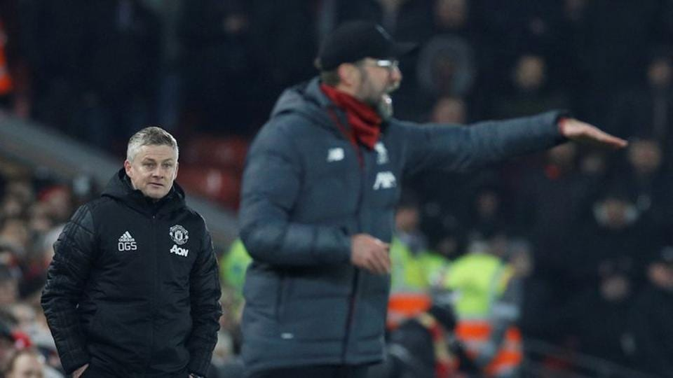 Liverpool manager Juergen Klopp and Manchester United manager Ole Gunnar Solskjaer