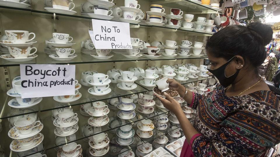 A woman browses crockery at a shop that has put up stickers of 'Boycott China Products' on display, in Tulshibaug, Pune, Maharashtra, India, on Friday, June 26, 2020.