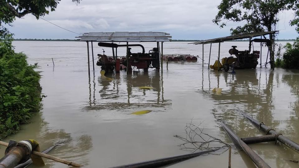 Water pumps installed on banks of Dangori River meant to carry water to  fight a gas well fire  lie submerged  in the  flood.