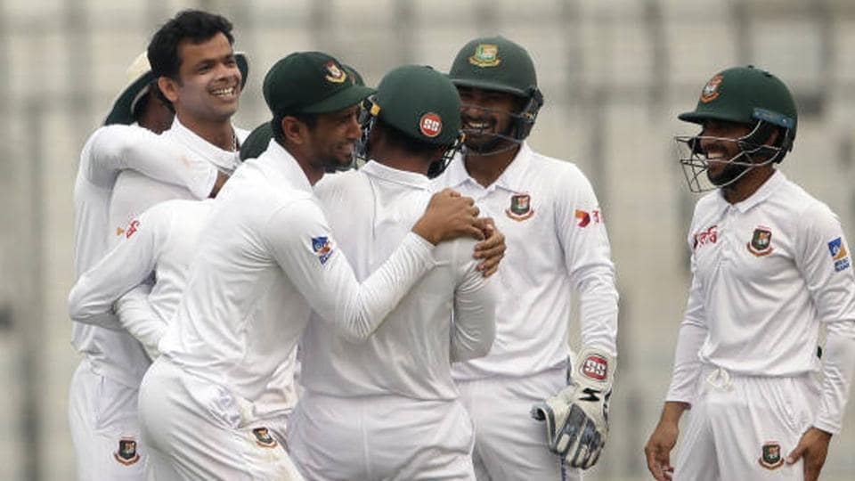 Players of the Bangladesh cricket team celebrate a wicket.