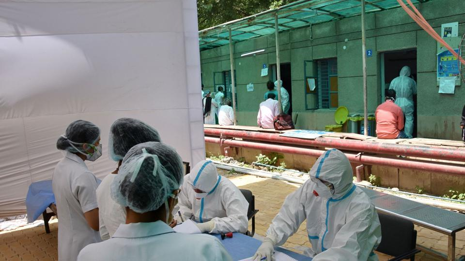 New Delhi: Doctors wearing protective suits sit outside the COVID 19 ward at Ram Manohar Lohia Hospital, during the nationwide lockdown in wake of the coronavirus pandemic, in New Delhi, Thursday, April 16, 2020. (PTI Photo)(PTI16-04-2020_000218A)