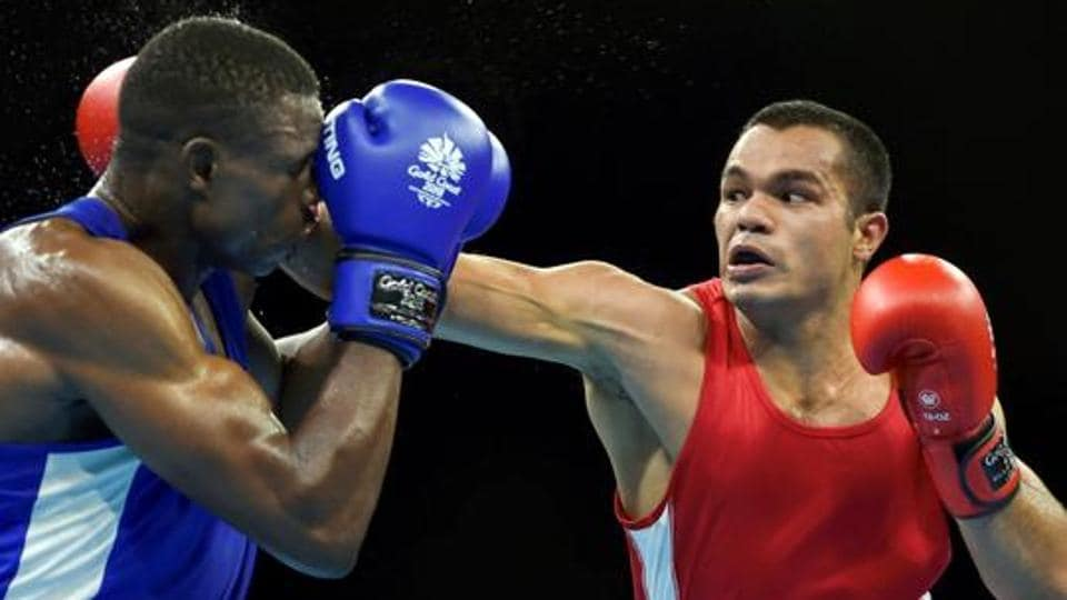 India's Vikas Krishan Yadav and Zambia's Benny Muziyo compete in the Men's 75kg category quarterfinals boxing bout at the Commonwealth Games 2018.