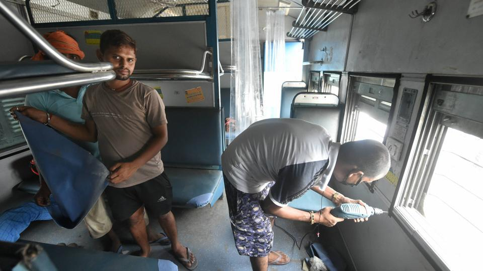 Railway technicians modify a train coach into an isolation ward for the treatment of COVID-19 affected patients in Lucknow.