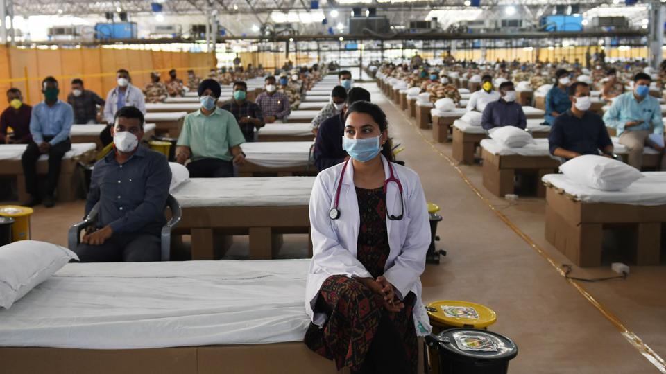 Medical professionals and health workers during the inauguration of Sardar Patel Covid Care Centre and Hospital by Union Home Minister Amit Shah and Delhi Chief Minister Arvind Kejriwal at Radha Swami Satsang Beas campus in Chhatarpur, New Delhi.