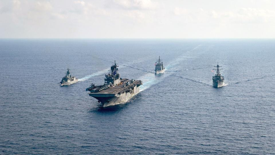 The Royal Australian Navy guided-missile frigate HMAS Parramatta (FFH 154) (L) is underway with the U.S. Navy amphibious assault ship USS America (LHA 6), the Ticonderoga-class guided-missile cruiser USS Bunker Hill (CG 52) and the Arleigh-Burke-class guided-missile destroyer USS Barry (DDG 52) in the South China Sea.