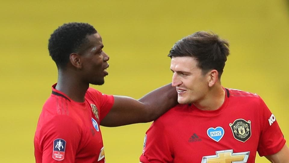 Soccer Football - FA Cup - Quarter Final - Norwich City v Manchester United - Carrow Road, Norwich, Britain - June 27, 2020 Manchester United's Harry Maguire and Paul Pogba celebrate after the match, as play resumes behind closed doors following the outbreak of the coronavirus disease (COVID-19) Catherine Ivill/Pool via REUTERS