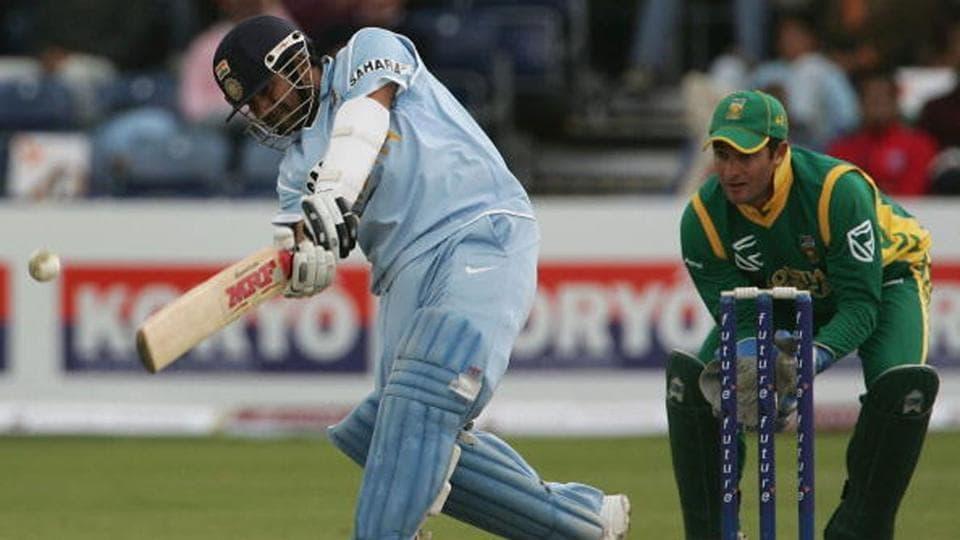 Sachin Tendulkar dances down the wicket.