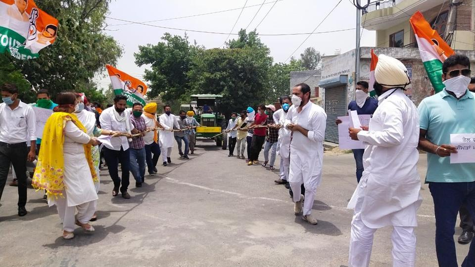 Youth Congress and NSUI workers pulling a tractor to oppose rising fuel prices in Sangrur on Monday.