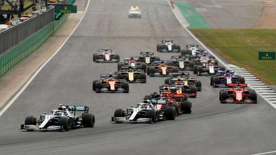 Mercedes' Valtteri Bottas leads Mercedes' Lewis Hamilton at the first corner of the race.