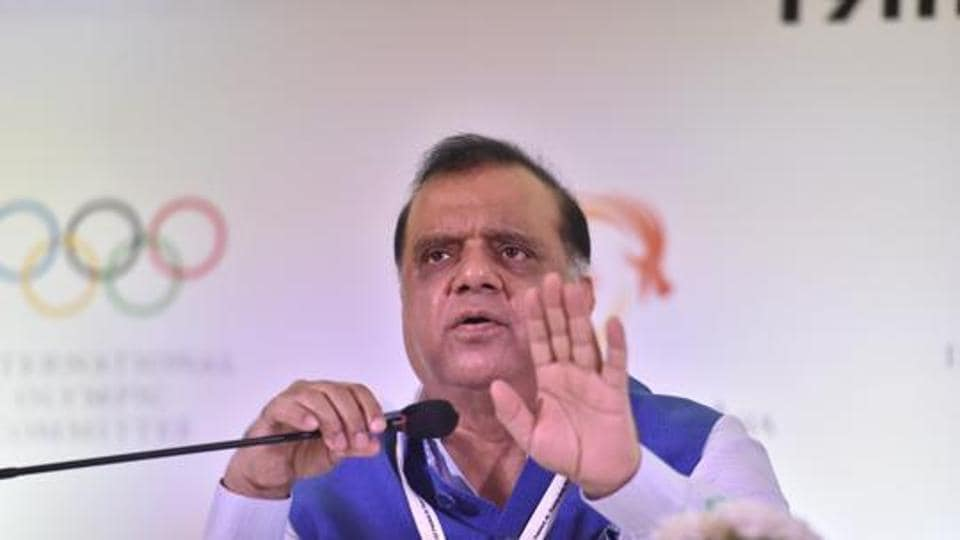 President of the Indian Olympic Association (IOA) Dr. Narinder Dhruv Batra ( L) addresses a press conference.