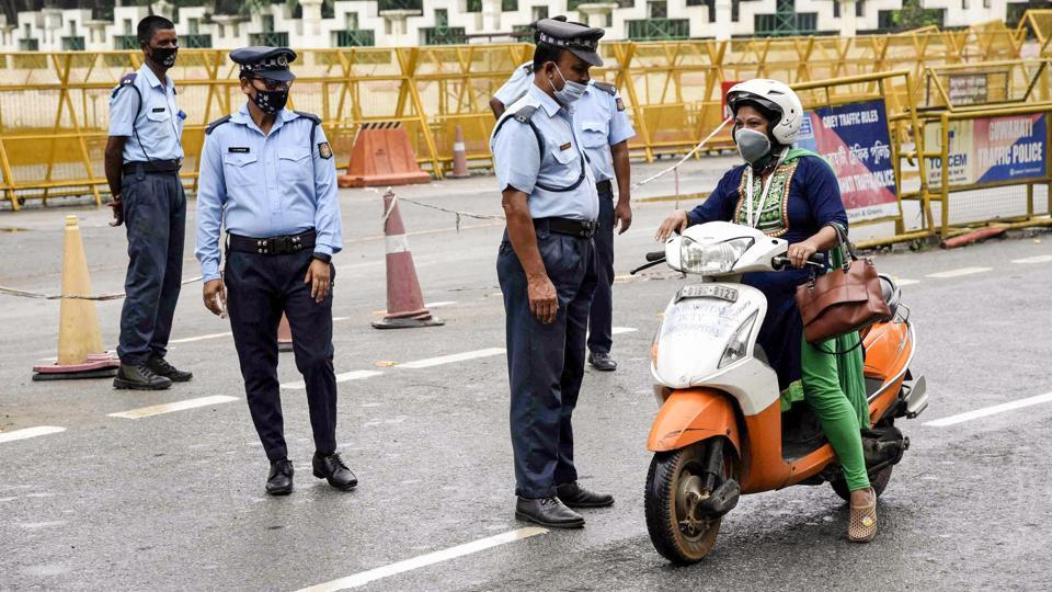 Security personnel enforcing a complete lockdown by the Assam Government to curb the spread of coronavirus stop a commuter in Guwahati on June 29. The number of coronavirus cases in Assam have risen to 7,795 yesterday after 302 more people tested positive for the virus according to the covid19india.orgdashboard. (PTI)