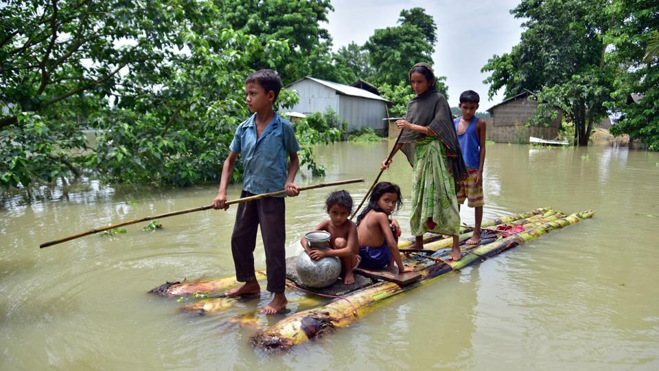 Villagers row a makeshift raft through a flooded field to reach a safer place at the flood-affected Mayong village in Morigaon district, in the northeastern state of Assam.