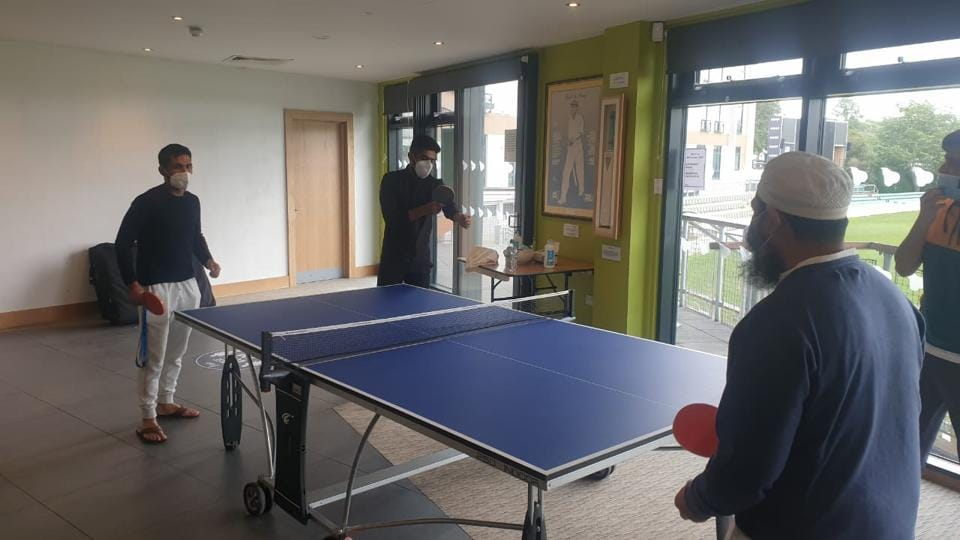 Pakistan cricketers playing table tennis.