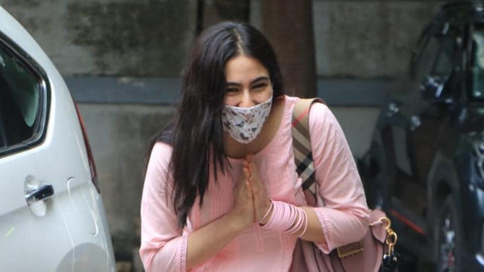Sara Ali Khan greets the paparazzi with a namaste.