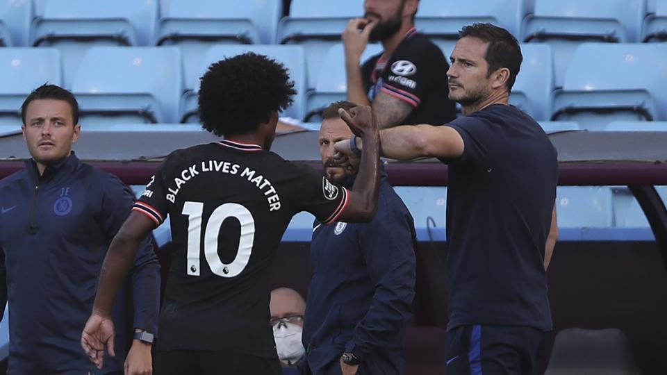 Chelsea's head coach Frank Lampard, right, greets Chelsea's Willian.