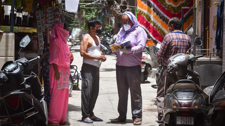 Civic workers conduct door-to-door survey to check the spread of Covid-19 in New Delhi.
