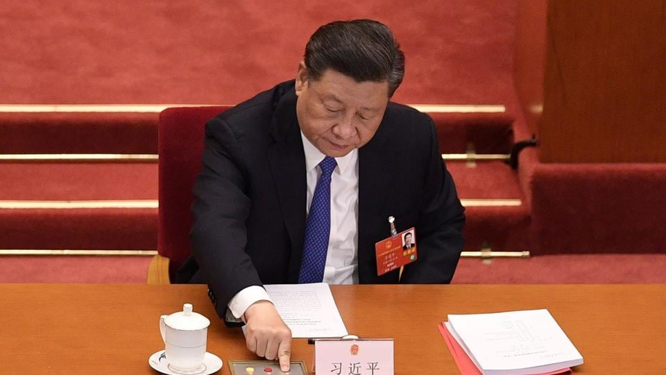 China's President Xi Jinping voting on a proposal to draft a security law on Hong Kong during the closing session of the National People's Congress at the Great Hall of the People in Beijing.