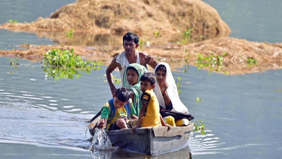 Flood affected villagers are transported on a makeshift raft towards a safer place, at Baghmari village near Kaziranga in Nagaon , Assam, June 30, 2020.