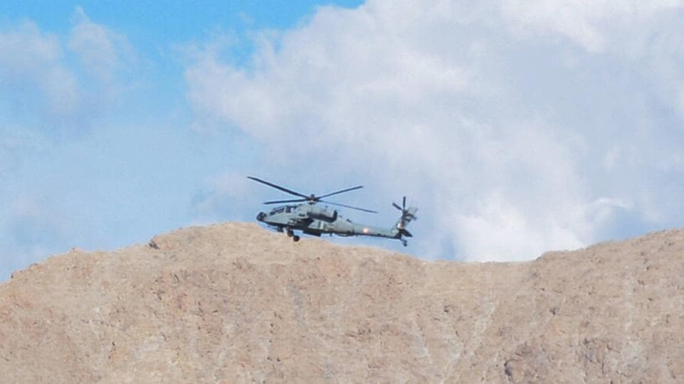 An IAF chopper flies in the skies above Leh in Ladakh on Monday.
