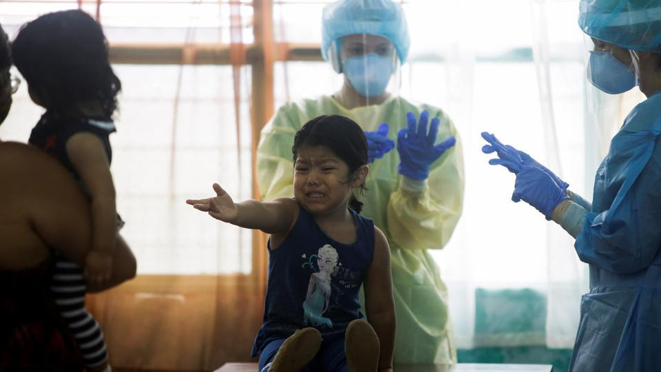 A child reacts before health workers take of a swab test for the coronavirus disease (COVID-19), in San Jose, Costa Rica June 26, 2020.  (Representational image)