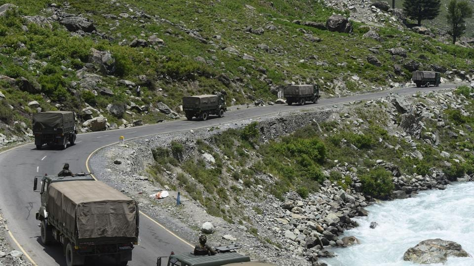An Indian Army convoy moves along a highway leading to Ladakh, at Gagangeer in Ganderbal district.
