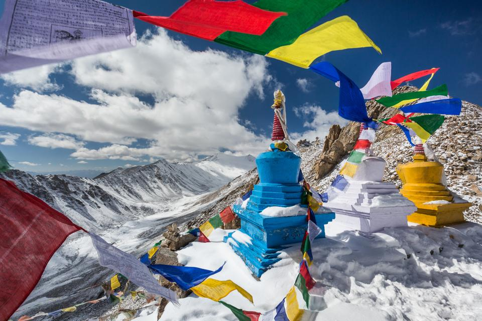 Prayer flags and stupas in the eastern Himalayas.