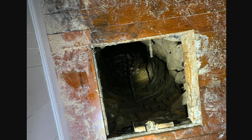 The image shows the well where the person fell.