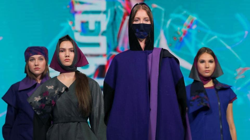 Models present creations Bells by Belarusian designer Svetlana Vorobyeva during a show at the festival and contest Fashion Mill, amid the coronavirus disease (COVID-19) outbreak, in Minsk, Belarus June 30, 2020.  (REUTERS/Vasily Fedosenko)