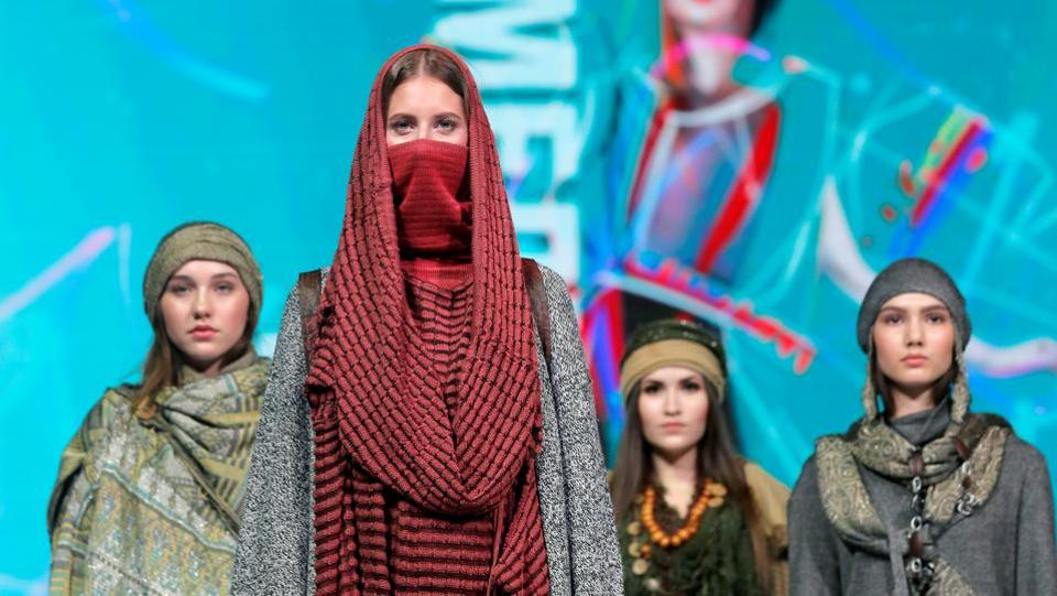 Models present creations Desert call by Belarusian designers Alina Loiko and Yuliya Shved during a show at the festival and contest Fashion Mill, amid the coronavirus disease (COVID-19) outbreak, in Minsk, Belarus June 30, 2020.  (REUTERS/Vasily Fedosenko)