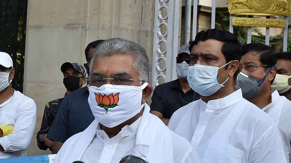 BJP State President Dilip Ghosh wears a mask with party symbol as he interact with media after attending a meeting with West Bengal Governor Jagdeep Dhankar, during  nationwide lockdown to curb coronavirus.