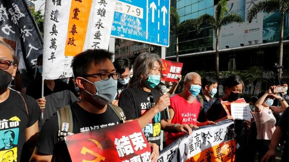 Pro-democracy protesters march during a demonstration near a flag raising ceremony on the anniversary of Hong Kong's handover to China in Hong Kong on July 1 2020.