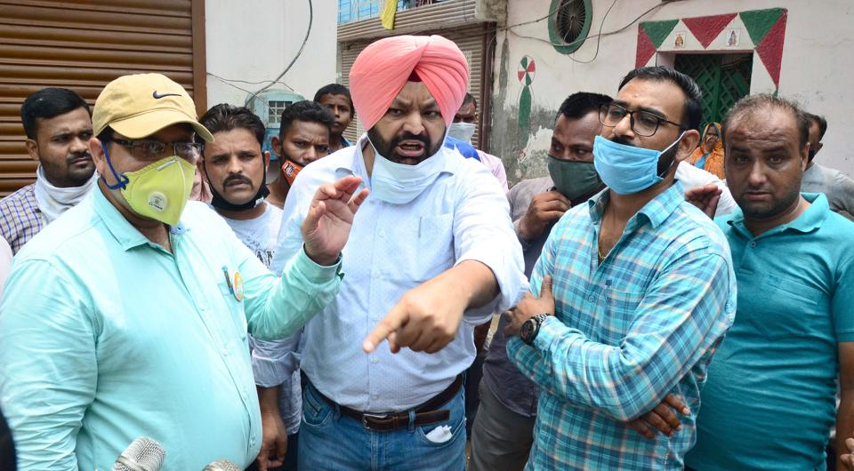 Residents of Hargobind Nagar protesting against the MC  in Ludhiana on Wednesday.