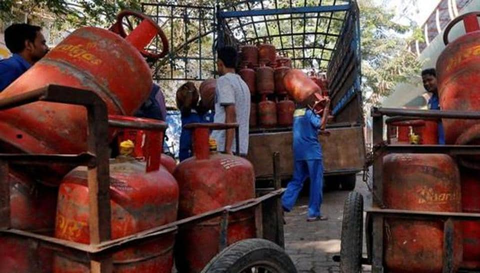 Workers load liquefied petroleum gas (LPG) cooking cylinders onto a supply truck outside a distribution centre in Mumbai.