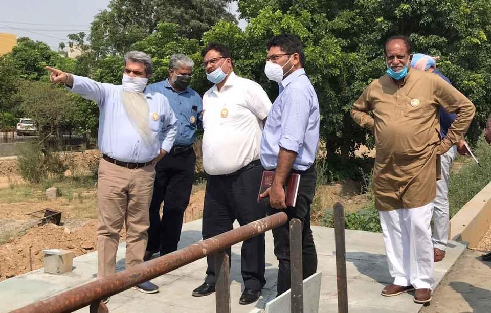 Punjab minister and Ludhiana (west) MLA Bharat Bhushan Ashu (L) takes stock of works at a project site in Ludhiana on Thursday.