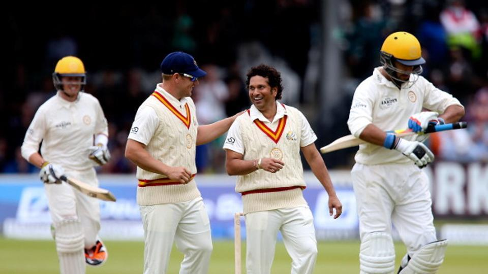 Sachin Tendulkar of MCC celebrates with team mate Arron Finch after dismissing Yuvraj Singh of Rest of the World (R) during the MCC and Rest of the World match at Lord's Cricket Ground on July 5, 2014 in London, England.