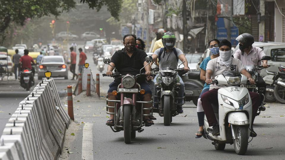Commuters wearing face masks seen on the road in Jangpura, New Delhi. According to government data, at the beginning of June, Delhi was conducting around 5,000 tests every day. This now has been scaled up to 17,000-20,000 every day. (Biplov Bhuyan / HT Photo)