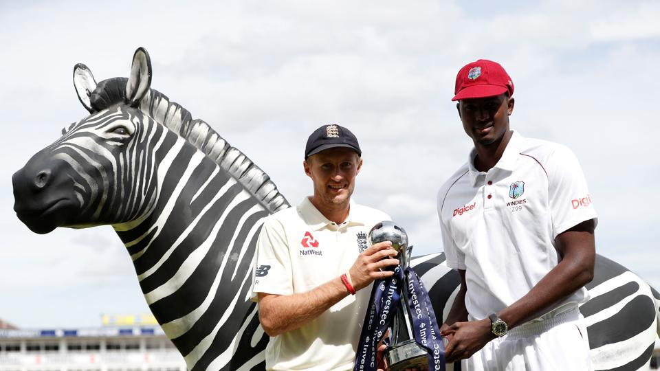 File photo of  England's Joe Root and West Indies' Jason Holder.