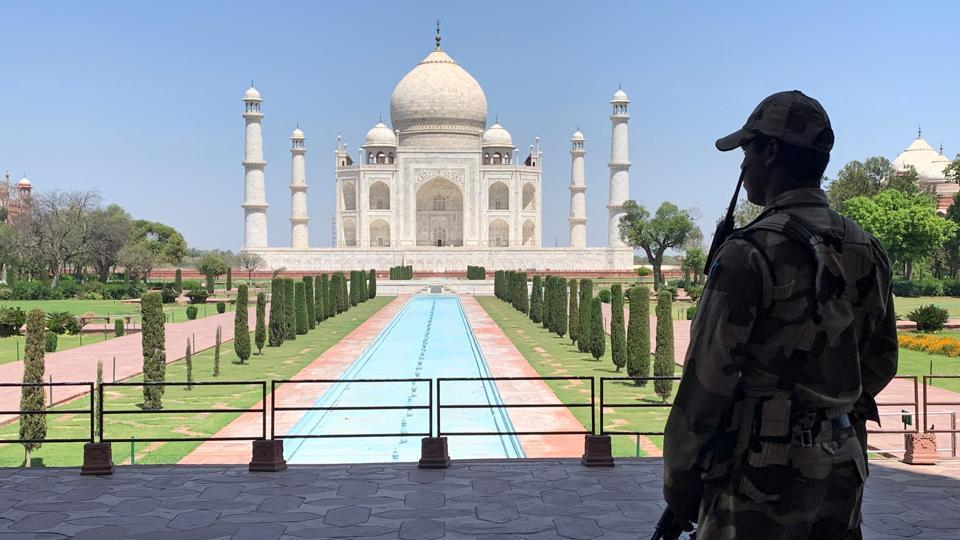 A Central Industrial Security Force (CISF) personnel stands guard inside the empty premises of the Taj Mahal.